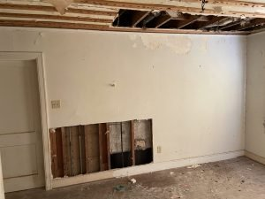 Holes in the wall exposed beams